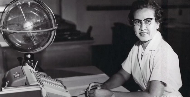 "A photograph of Katherine Johnson, a ""Computer"" employed by NASA and it's predecessor NACA, to calculate orbital trajectories, sits at her desk with a globe, or ""Celestial Training Device."""