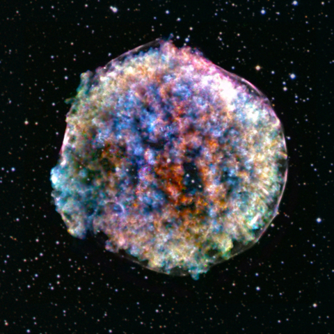 An astronomical, image of the Supernova Remnant 1572, a cloud of dust and gas left behind by the supernova observed in 1572.
